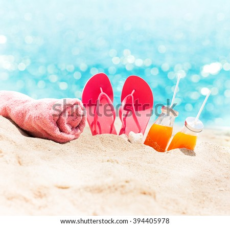 Sunny Beach Blue Sea Pink Flip Flops Towel Orange Juice Summer Holiday Concept - stock photo