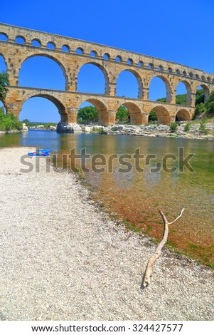 Sunny beach in front of Pont du Gard - an ancient Roman aqueduct near Nimes, France