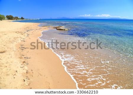 Sunny beach near the Aegean sea, Greece - stock photo
