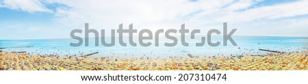 sunny beach with sunshade on blue cloudy sky, banner,panorama - stock photo
