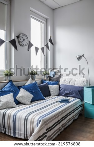 Sunny bedroom for children in the house  - stock photo