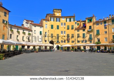 Sunny buildings  and terraces in Piazza dell'Anfiteatro, Lucca, region of Tuscany, Italy