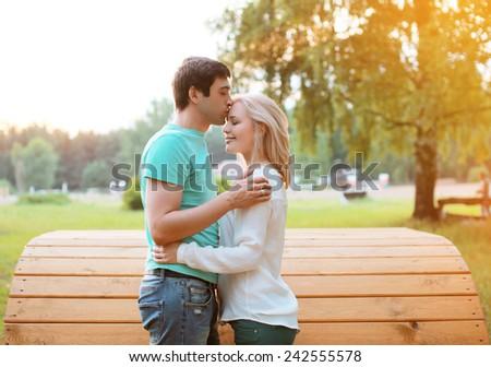 Sunny couple in love outdoors, warm tender feelings - stock photo