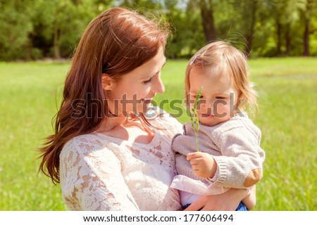 sunny day enjoying female with daughter - stock photo