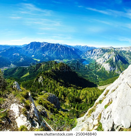 Sunny day in the mountains. Mountain landscape with rocks and lake - stock photo