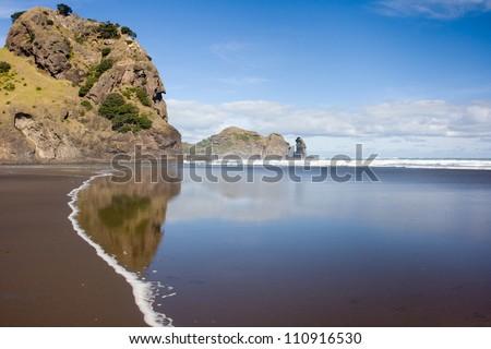Sunny day on a remote beach near Auckland, New Zealand - stock photo
