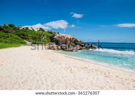 Sunny day on Anse Nord D'Est beach in the north of Mahe Island, Seychelles