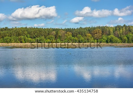 Sunny day on the lake. - stock photo