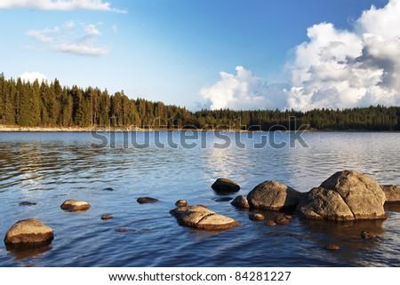 sunny day on the mountain lake - stock photo