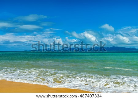 Sunny day with blue cloudy sky at tropical beach and sailboat on the horizon, Koh Samui, Thailand