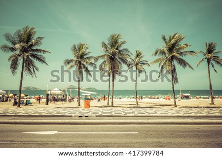 Sunny day with Palms on Ipanema Beach in Rio De Janeiro, Brazil. Vintage colors - stock photo
