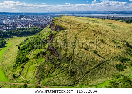 Sunny Edinburgh and green hills in summer - stock photo