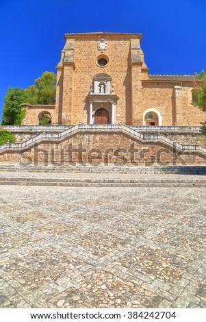 Sunny facade of the Baroque building of the Granada Charterhouse (Cartuja monastery) in Granada, Andalusia, Spain - stock photo