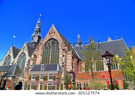 Sunny facade of the Oude Kerk (Old Church) in Amsterdam, the Netherlands - stock photo