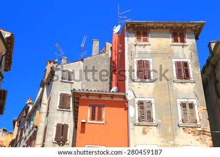 Sunny facades of old buildings inside Venetian town, Rovinj, Croatia