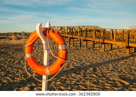 Sunny Guardamar beach and its lifesaver post, Costa Blanca, Spain