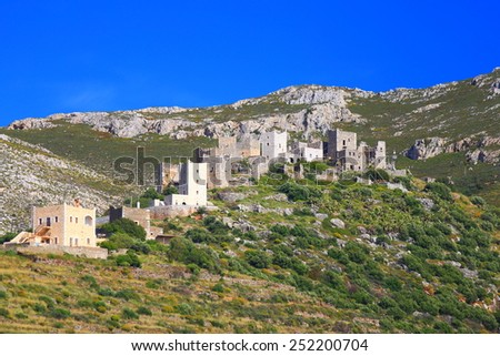 Sunny hill and small village with tower shaped houses in Vatheia, Mani peninsula, Greece