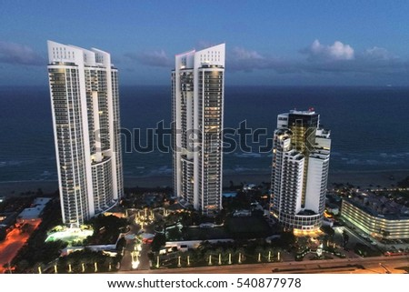 SUNNY ISLES BEACH - DECEMBER 20: Aerial image of Trump Towers located on Collins Avenue completed in 2008 with the Atlantic Ocean in the background December 20, 2016 in Sunny Isles Beach FL