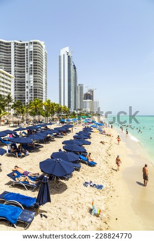 SUNNY ISLES BEACH, USA - AUG 2014: people at Jade beach in Sunny Isles Beach, USA. Jade Beach and Ocean were completed in 2009 with a elevation of 549 feet located at 170th Street.