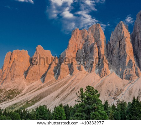 Sunny late afternoon view of Odle mountain group knife-edge peaks as taken from Malga Glatsch refuge in Puez-Odle Nature park, Funes valley, Dolomites, Trentino Alto Adige, Bolzano, South Tyrol, Italy