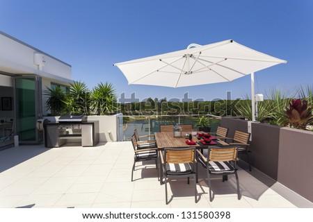 Sunny luxurious penthouse balcony - stock photo