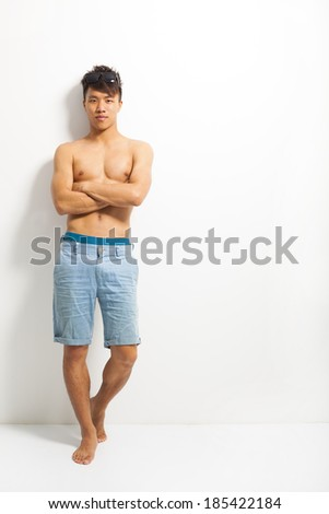 sunny man cross arms and standing  - stock photo