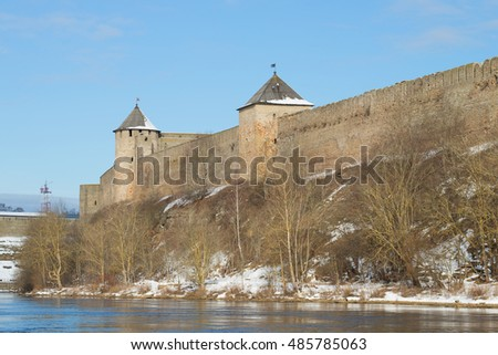 Sunny march day at the walls of the Ivangorod fortress. Ivangorod, Russia