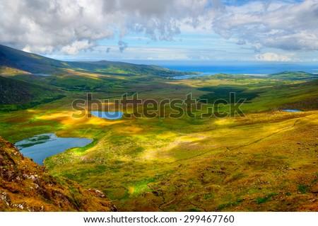 Sunny mountain and lake landscape on Dingle peninsula, Ireland - stock photo
