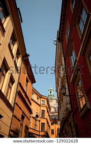 Sunny narrow street in city center, Stockholm, Sweden - stock photo