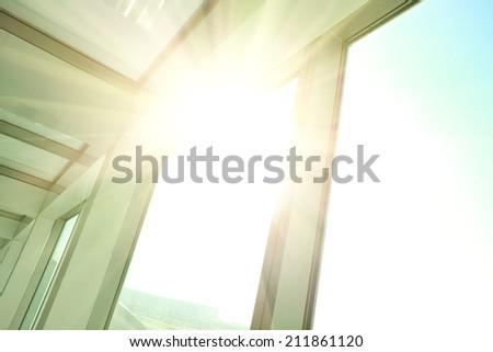 Sunny on modern glass office buildings windows - stock photo