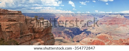 Sunny panorama with white clouds of a Grand Canyon