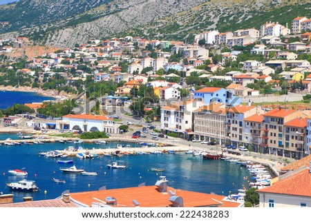 Sunny pier and buildings of an old town near the Adriatic sea, Senj, Croatia
