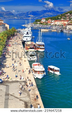 Sunny pier of a Venetian old town near the Adriatic sea, Trogir, Croatia - stock photo