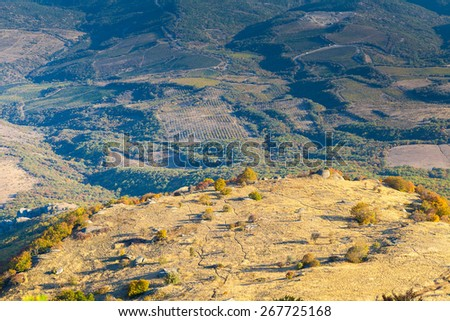 Sunny plateau and the green fertile fields - stock photo