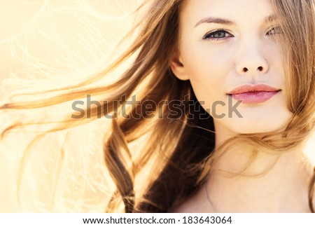 sunny portrait of a beautiful young girl - stock photo