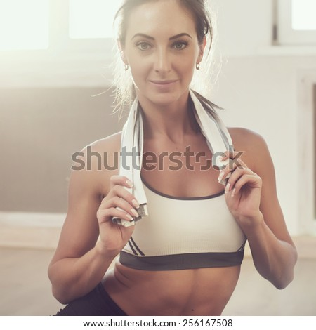 Sunny portrait of beautiful athletic sportive woman after the training  using  toned style instagram filters.  Toned photo Instagram filter. - stock photo