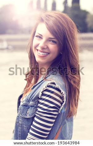Sunny portrait of beautiful caucasian girl  - stock photo