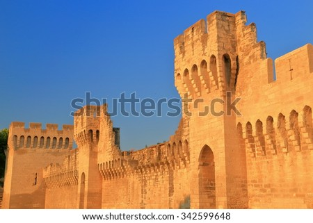 Sunny remains of tall walls around the old town of Avignon, Provence, France - stock photo