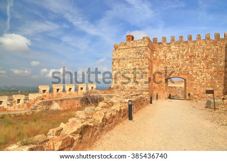 Sunny road and fortified gate of the Castle of Sagunto, Valencia, Spain