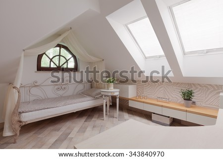 Sunny room in the attic in romantic style