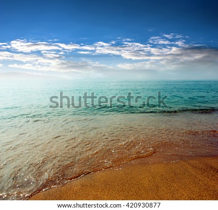sunny sandy beach of the Spanish Mediterranean coast