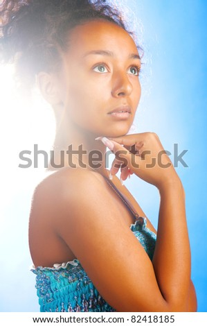 sunny sexy beautiful woman on sky background - stock photo