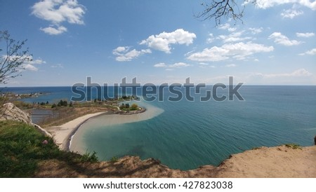 Sunny shoreline with clouds