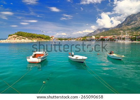 Sunny shores of the Adriatic sea and small leisure boats, Makarska, Croatia - stock photo
