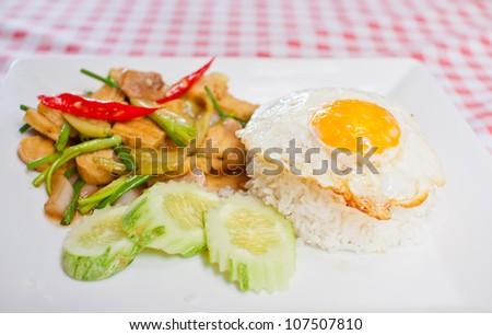 sunny-side up egg on rice with spicy fried vegetable and tofu,Thai menu