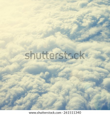 Sunny sky abstract background, beautiful cloudscape.Special toned photo in vintage style - stock photo