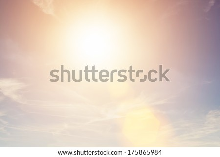 Sunny sky background in vintage retro style with sun flare - stock photo