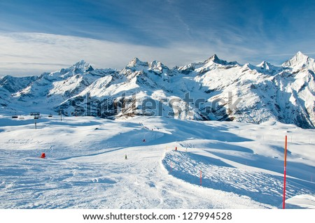 Sunny slope in swiss Alps - stock photo