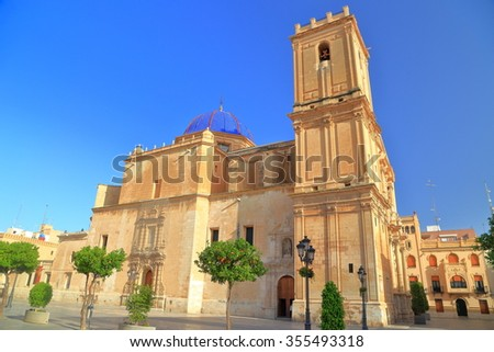 Sunny square near the building of Santa Maria Basilica in Elche, Alicante, Spain - stock photo