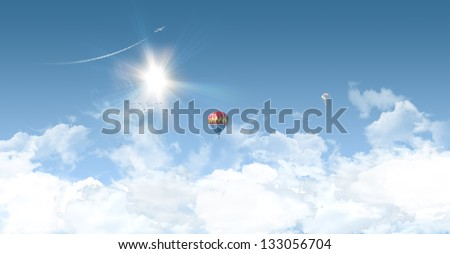 Sunny summer background with clear blue sky, balloons and aeroplane - great copy-space for posters, cards or banners - stock photo